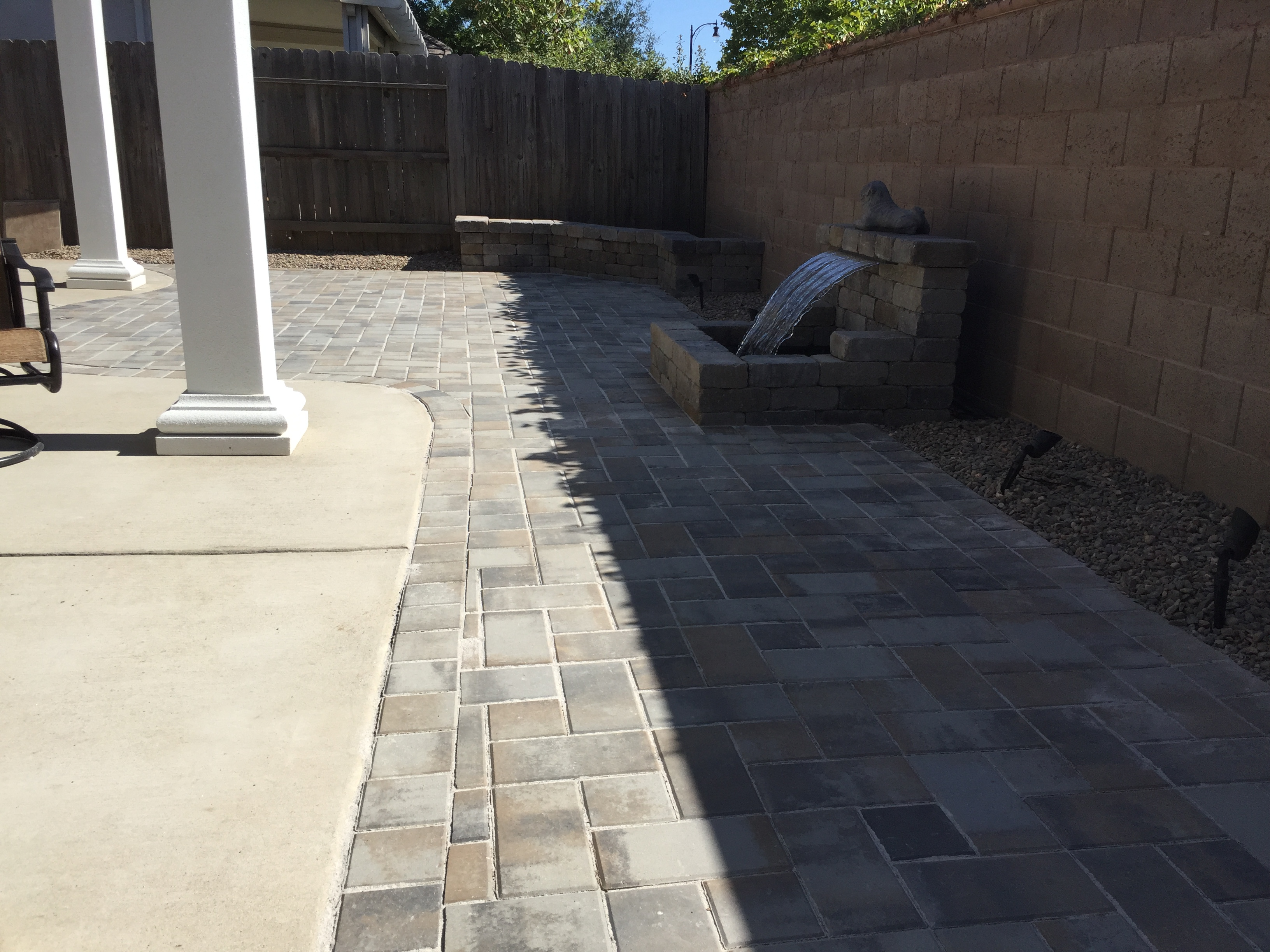 Paver Patio Roman Stone Seating Walls Roman Stone Water Feature